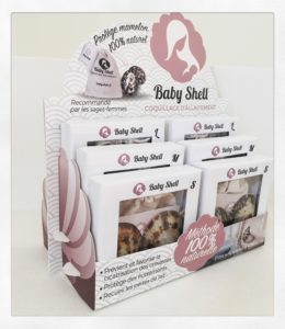 Présentoir Baby Shell pour disposer 6 boîtes de paire de coquillages d'allaitement. Disponible pour les pharmacies et magasins pour bébé.